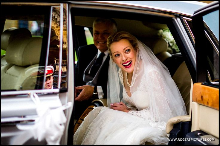 Laura looks stunning as she arrives at Sherborne Abbey to marry Dan -