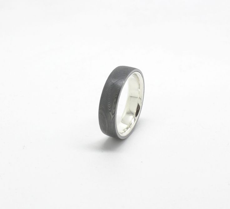 Sterling Silver and Damascus Wedding band handcrafted in the Rohan Jewellery workshop. #rohanjewellery #rohanmilne #leederville #handcraftedjewellery #damascus #sterlingsilver #weddingband