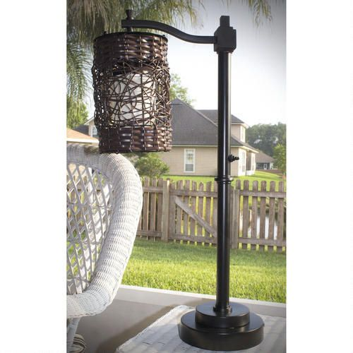 Can you believe this is designed for outdoors?! Umbrella Outdoor Table Lamp with Offset Base - Tropical Wicker Shade #unique #lights #outdoors #outdoorliving