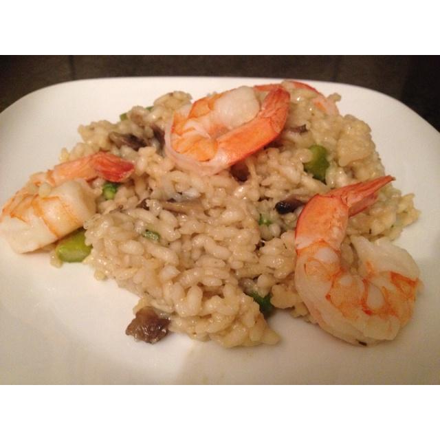 Dinner is served - prawn, asparagus and mushroom rissotto. My variation on http://www.taste.com.au/recipes/13827/quick+prawn+asparagus+mushroom+risotto