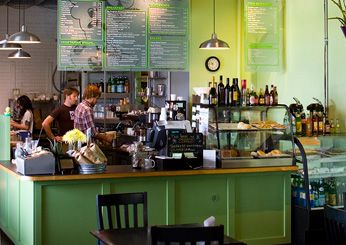 Progress Coffee in Austin, Texas, made Food & Wine's list of America's Best Coffee Bars! Progress blends art, music and sophisticated coffee. Supporting Austin's indie community, the shop sources custom blends from local roasters Owl Tree Roasting, organic produce for the café menu, and even gives away its nitrogen-rich coffee grounds to patrons who compost. The industrial-chic loft provides ample room for record-release parties, art openings and other events.