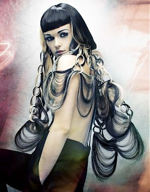 A long black straight quirky avant garde wavy hairstyle by D Ambrose