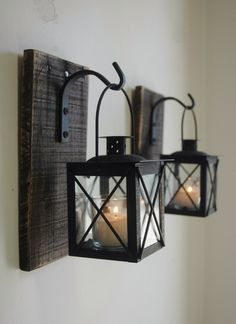 lantern pair with wrought iron hooks on recycled wood board for unique wall decor home - Unique Wall Decor