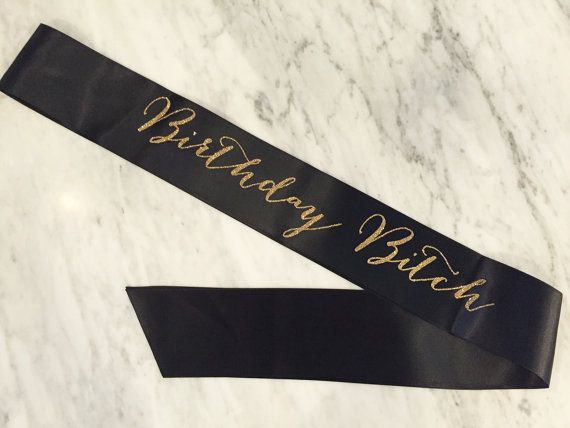 Make the guest of honor feel special! Great for photos! This is a quality sash that everyone will love!  3 wide double faced satin ribbon with vinyl glitter print (does not flake off at all!) sash is approx. 70 long, ends are cut on an angle and heat sealed it is open ended and easy to adjust fit to the wearer. comes with small rhinestone pin  sash colors are shown in the 2nd last photo glitter colors are shown in the last photo colour shown is black with gold glitter print  Please specify…
