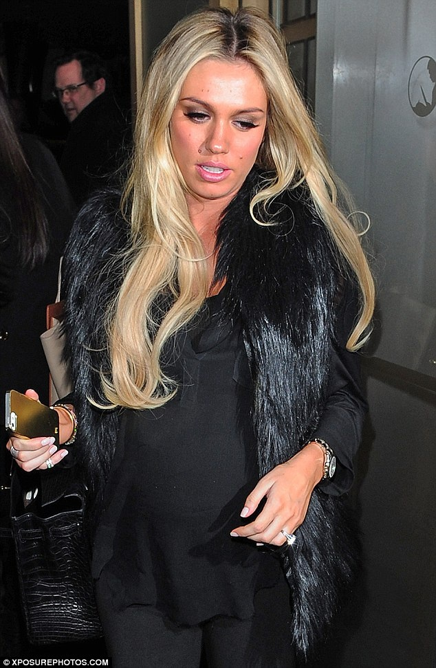 Petra Ecclestone dresses up an otherwise ordinary outfit with animal print wellies.  More photos and discussion of Petra in blog post.