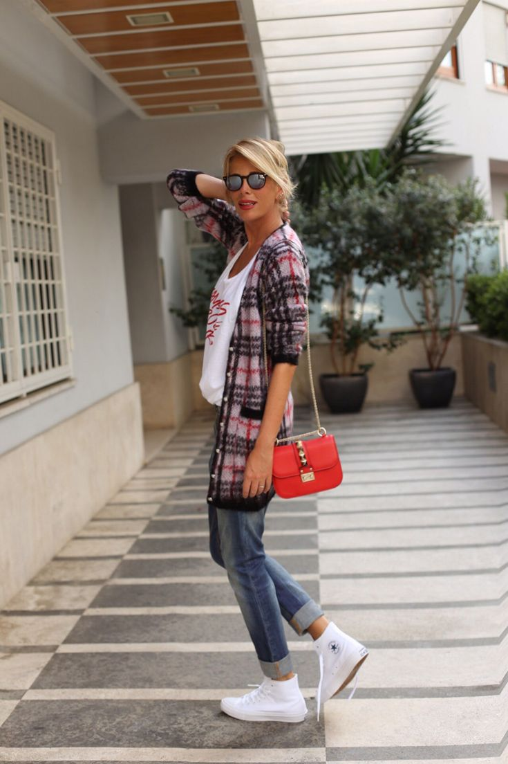 I really love this outfit but it's more expensive for me! the cardigan is from Versace and the bag is obviously a Valentino! but don't worry you can get the look for less! be inspired!!  http://www.lapinella.com . tartan cardigan jeans converse white red sunglasses