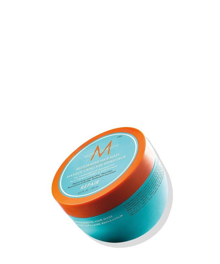 For damaged hair in need of instant repair, Moroccanoil® Restorative Hair Mask is a 5–7-minute revitalizing treatment that reconstructs hair and infuses protein back into strands that have been damaged by chemical treatments or heat styling. Its high-performance, deeply restorative formula is rich in argan oil, shea butter and reparative proteins that restore hair's elasticity and rebuild its strength from the inside out.
