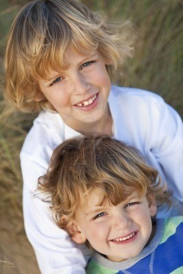 Two young boys, brothers, happy