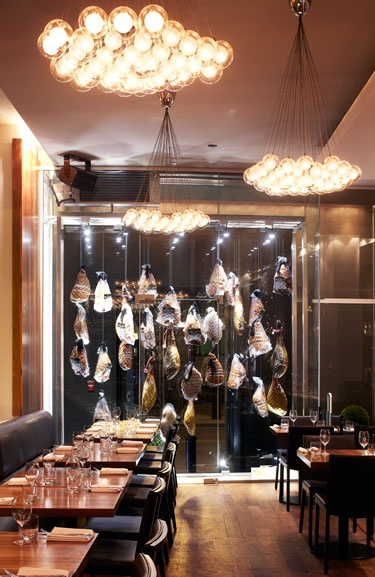 Hambar (suspended meats on butcher hooks in the entrance showcase) in Montreal, QC - designed by GH+A