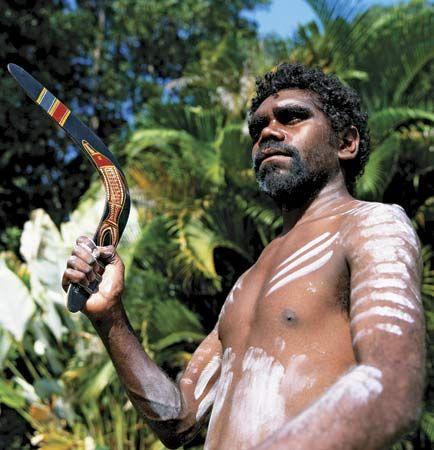 Australia & meet an Australian Aboriginal . Bonus points for the boomerang