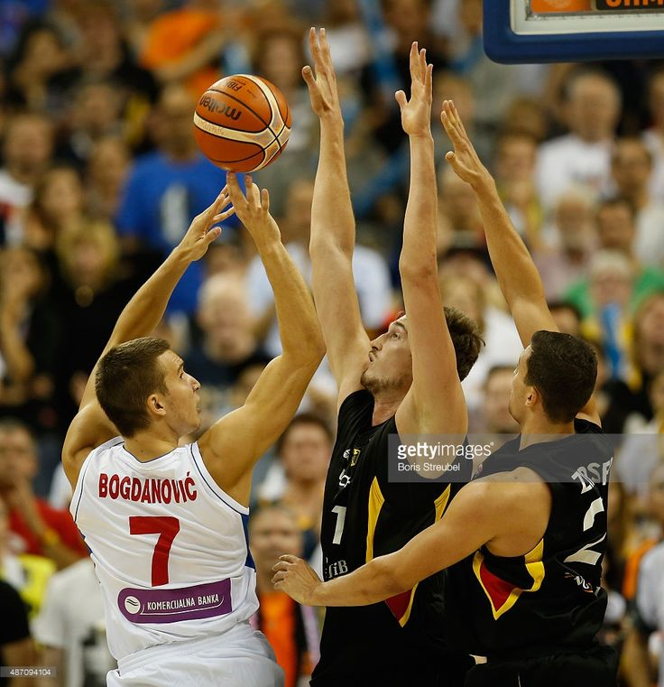 Bogdan Bogdanovic of Serbia (L) drives to the basket against Germany during the FIBA EuroBasket 2015 Group B basketball match between Serbia and Germany at Arena of EuroBasket 2015 on September 6, 2015 in Berlin, Germany.