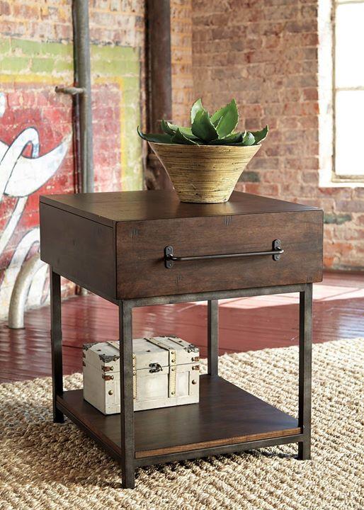 Nuestra mesa lateral #Starmore es perfecta para los amantes del diseño industrial urbano. La hermosa combinación de madera oscura y metal claramente se roba el espectáculo  Para consultar su precio escríbenos a ventas@ahs.cl  #AshleyFurnitureHomeStoreSantiago #AshleyFurnitureHomeStore #estilo #muebles #accesorios #diseño #mesa   ---  Serie: T913 Starmore T913-3 Rectangular End Table