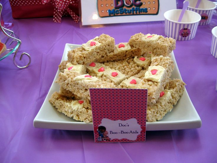 Doc McStuffins party table decor. Doc's boo boo aids - Rice Krispie bandaids.