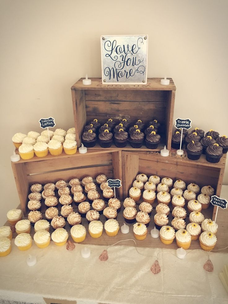 Cupcakes displayed in wooden crates for wedding