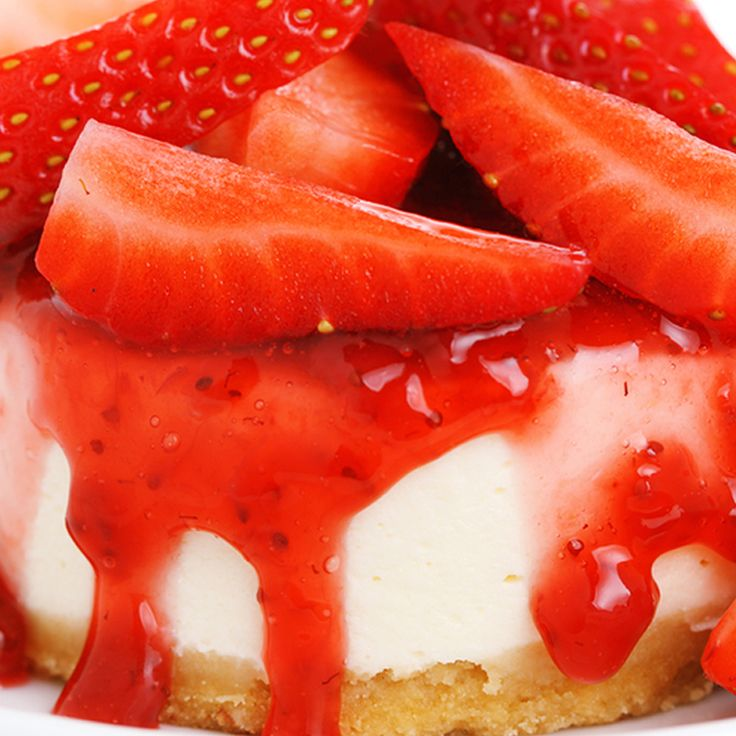 A superb summertime strawberry cheesecake recipe.. Cheesecake with Strawberry Sauce Recipe from Grandmothers Kitchen.