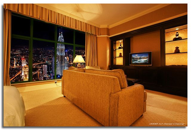 """I am in Kuala Lumpur this week, finally got my room with THE view. Well, just in my fantasy...The hotel is quite nice, but not the view, so I just changed it with a little help of Photoshop.  Technique used: Digital Blending, digital composite. The """"View"""" is from this shot that I took from the KL Tower.  Digital Blending Set   Night Photography Set   Malaysia Set   Most Interesting shots."""