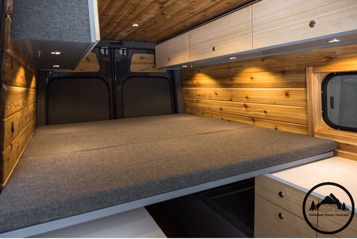 Converted Mercedes Sprinter Van by Townsend Travel Trailers. Features include; kitchen galley, tuck away bathroom, stowaway bed, two bench seats, and two overhead cabinets.