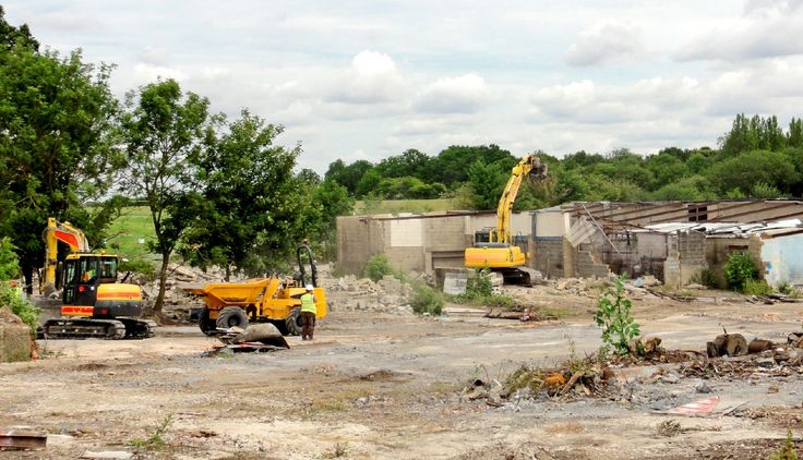 Jehovah's Witnesses in Britain are relocating their branch office from Mill Hill, London, to a location some 70 kilometers (43 mi) to the east, near the city of Chelmsford, Essex. Between January and August 2015, workers set up the support sites to get ready for construction to begin.      July 23, 2015—Branch site    Contractors remove existing structures to clear the way for construction of the new branch.