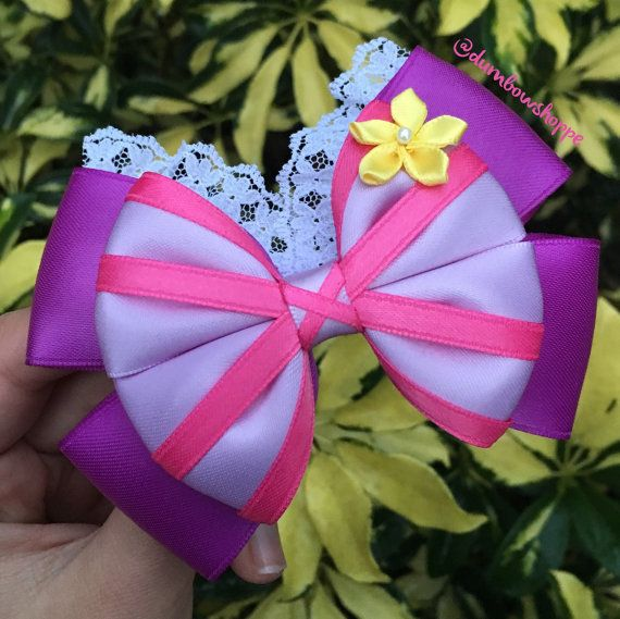 Dont hide in your tower anymore, show off your flowing locks with this beautiful bow. The Rapunzel Hair Bow will be the perfect addition to any