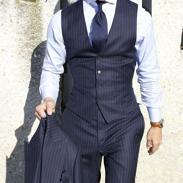 fitted pinstripe three piece suit. blue. watch. classic. corner office. like a boss. style.
