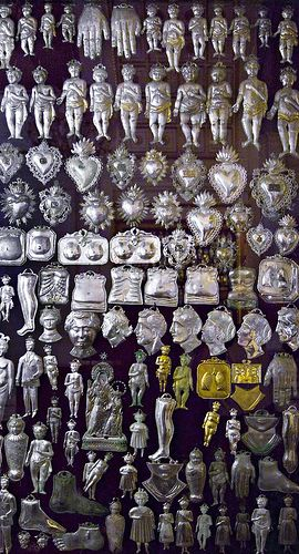 milagritos - serve an important role in Mexican devotion. Tied to the robes of saints.