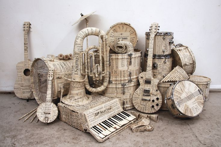 Hermes (UK) Christmas 2009  Music manuscript covered instruments and map covered suitcases to complete window displays across the country. Creative Director: Rebecca Cocks.: Window Display, Hermes, Music Instruments, Paper Mache, Sheet Music, Suitca, Christmas Window, Mr. Beans, Windowdisplay