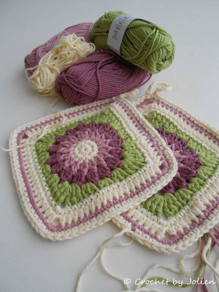 Rosie Posie potholders, from Crochet by Jolien.  Free pattern!  Think the squares would make a very pretty afghan!  Love the colors!
