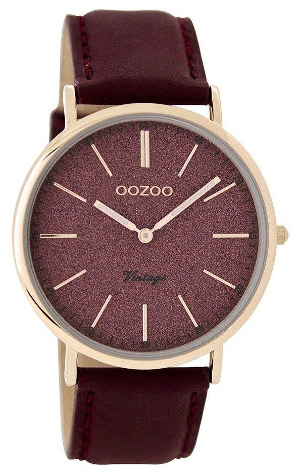 OOZOO Horloge Vintage 40 mm C8197. Elegant en trendy dameshorloge met stalen, rosékleurige kast. De wijzerplaat in roodtinten met een mooie glinstering in de steentjes is voorzien van rosékleurige index en wijzers. De donkerrode horlogeband sluit door middel van een gespsluiting. De doorsnee van de kast is 40 mm. Trendy en elegant model uit de OOZOO vintage-collectie.