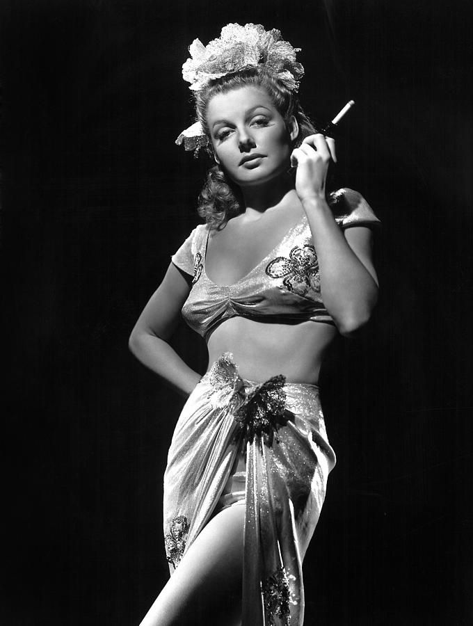 Ann Sheridan, Ca. 1940s showgirl vintage fashion style print ad portrait movie star glamour girl crop top bandeau tie skirt sarong metallic gold silver?