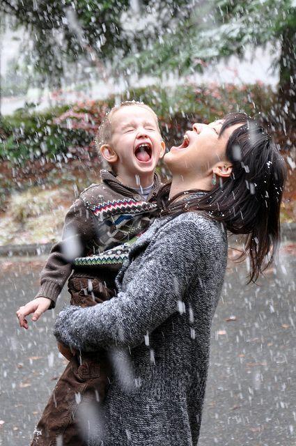 mother and child enjoying the rain.