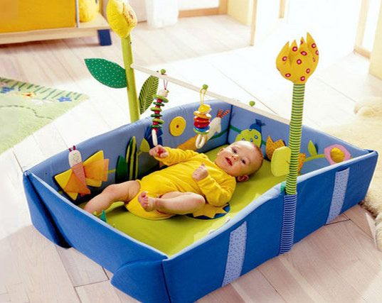 As the mother of a 5 month old, I recently found myself doing in-depth research to try to find a cute, classy and eco-friendly play gymboree to give my little one a safe and stimulating space in which to play. Scared off by all the insane-colored, battery-operated, plastic-fantastic Fisher Price options available at chain stores, I felt on a quixotic quest to find the elusive gymboree that would both please my demanding baby and also please his design-conscious parents. I wanted to find…