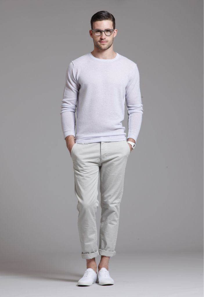 Consider wearing a beige crew-neck jumper and beige chinos to get a laid-back yet stylish look. A pair of white plimsolls will seamlessly integrate within a variety of outfits.   Shop this look on Lookastic: https://lookastic.com/men/looks/beige-crew-neck-sweater-beige-chinos-white-plimsolls-white-watch/13140   — Beige Crew-neck Sweater  — White Rubber Watch  — Beige Chinos  — White Plimsolls