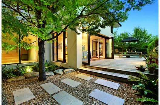 Pavers with gravel at Plan 496-1 by Melbourne architect Leon Meyer...