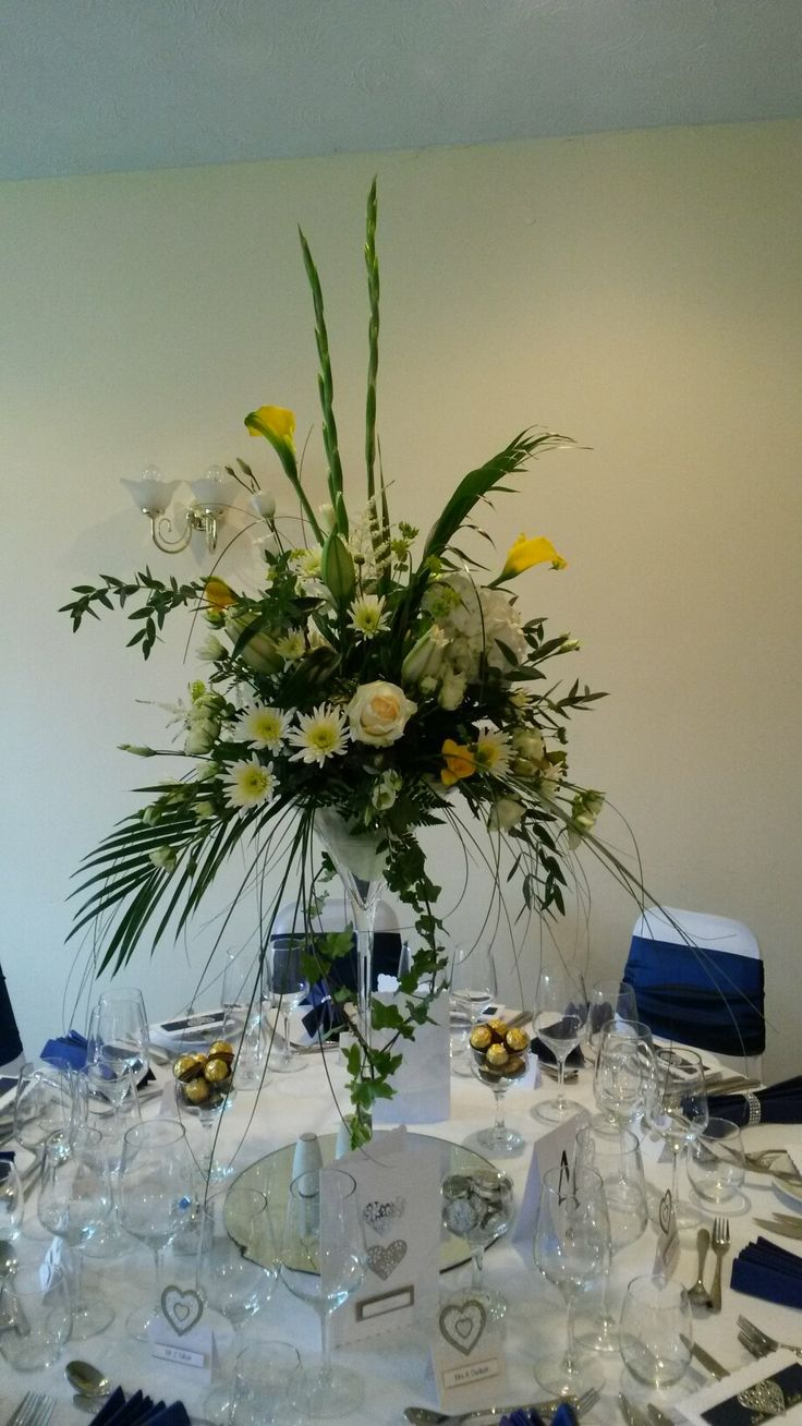 Yellow and white table centres for a wedding