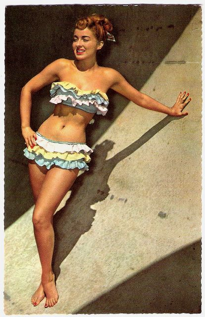 1950's Confectionery hued ruffles and super cute curled locks tied up with a scarf #50sfashion #vintageswimsuit #vintageswimwear