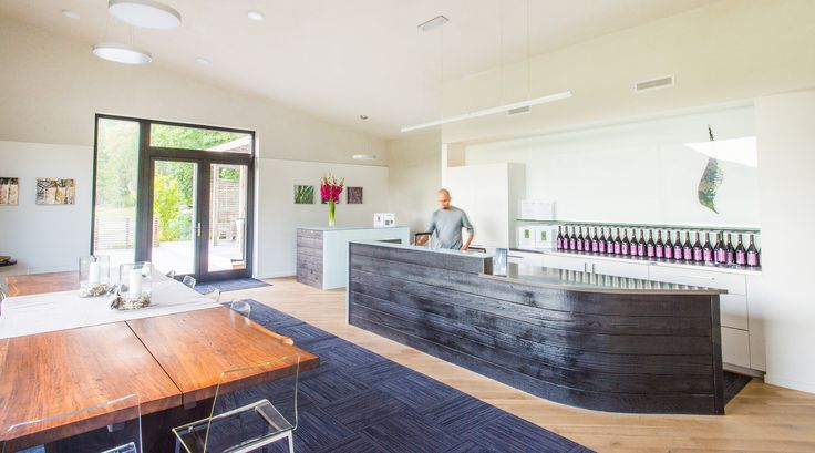 Inside the tasting room at Cowhorn Vineyard. Green Hammer Architect, Erica Dunn, designed the tasting room to meet Living Building Challenge petal certification - the first tasting room in the world to achieve this goal - and incorporated the same Passive House standards the residence will be certified under. 2YokeDesign provided interior design.