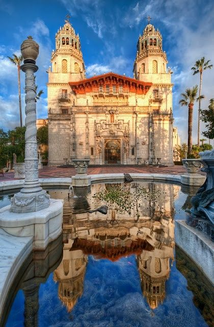 Hearst Castle, CA, USA. The Enchanted Hill is a National and California Historical Landmark mansion located on the Central Coast of California, United States. It was designed by architect Julia Morgan between 1919 and 1947 for newspaper magnate William Randolph Hearst, who died in 1951. In 1957, the Hearst Corporation donated the property to the state of California.