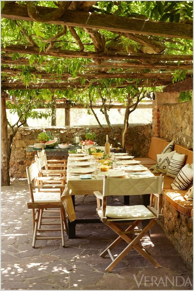 A Wooden Beam Pergola with a Vine in a Tuscan Patio