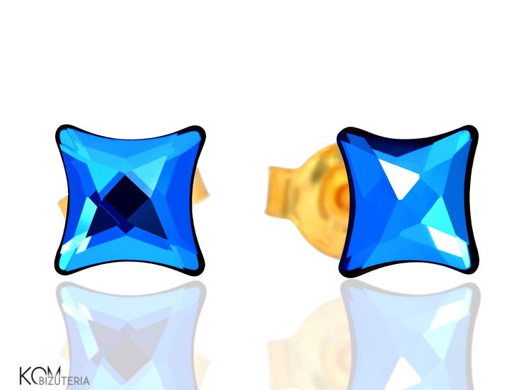 DOT - blue starlet - gold-plated silver stud earrings with Swarovski® crystals.  Delicate stud earrings made from high quality silver plated with 24 karat gold embellished with intense cobalt blue colored Swarovski® crystals in a shape of a little star.  Ideal for children and as a subtle accent.