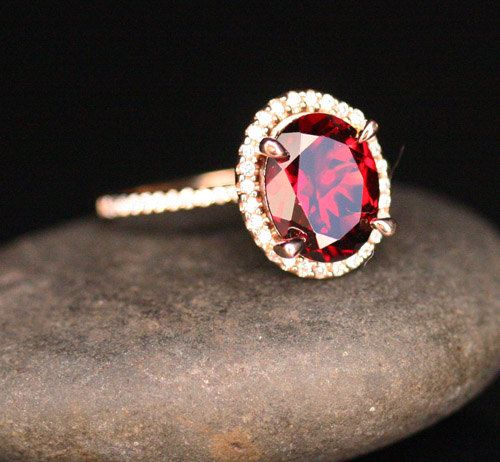 This Stunning delicate and feminine 14k Gold Single Halo Ring Features a flawless Natural Red Garnet Oval measuring 10x8mm and surrounded with