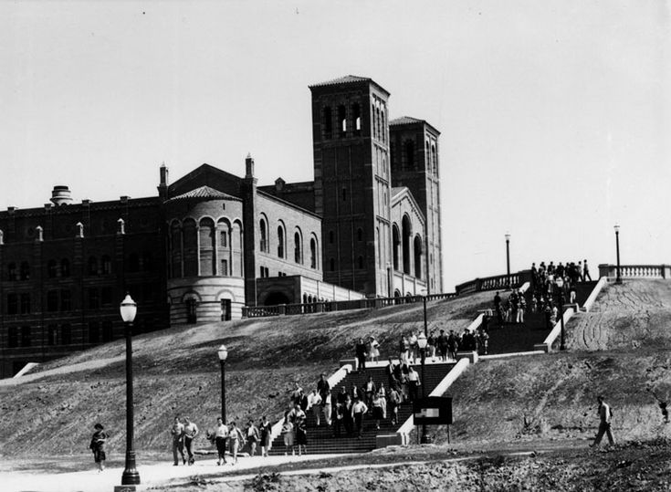 (1929) - View is looking northeast up Janss Steps, as the UCLA Westwood campus opens in 1929. The twin towers of Royce Hall appear in the background. Groups of people are walking down the steps.