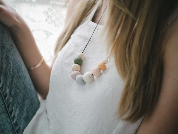 Shall we?   Meticulously hand-crafted polymer clay beads in carefully chosen natural colours, to compliment any outfit.   Beads are strung on a waxed cotton cord, stronger than leather, but with a natural suede look.   Cord length is adjustable to suit multiple necklines.   A perfect treat for any