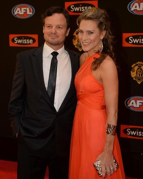 St Kilda Coach, Scott Watters and Emily Watters stunning earrings and arm cuff Brownlow 2013