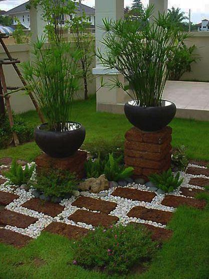 I like the idea of pots on pillars and the zen like feel