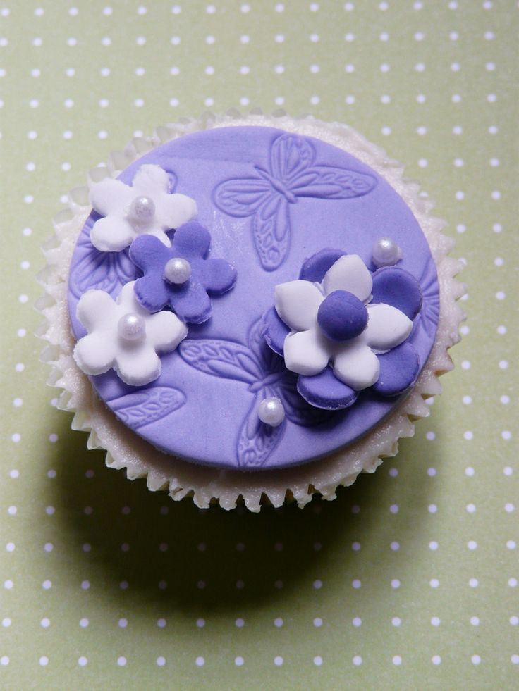 purple themed bridal shower%0A spring butterfly cupcakes in purple