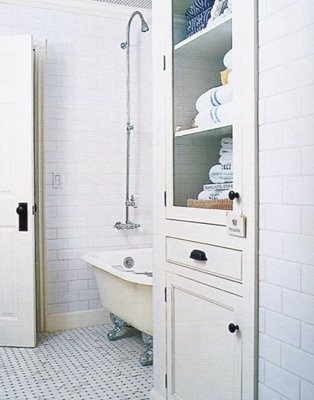 built in bathroom storage - frame out shelves and add cabinet door