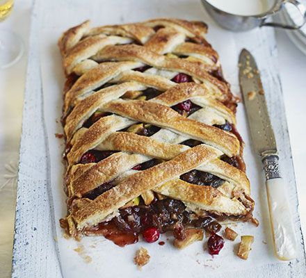 Forget fiddly mince pies, fill puff pastry with juicy mincemeat and fruit and serve this festive dessert in slices - perfect for entertaining