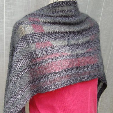 Inspired by winter trees silhouetted against cold skies, this perfect evening shawl plays with luxurious contrasts made in simple stripes. The sheer mohair/silk stripes give a hint of what's hiding underneath, so you don't feel that your party dress has vanished under a big wrap. The irregular widths of the stripes keep it modern and interesting to knit. This is a perfect TV or knit-night project for a more experienced knitter. I believe knitting doesn't have to be difficult to be beautiful.
