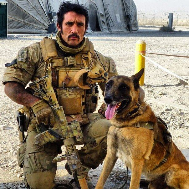 British SAS soldier with his dog in Afghanistan
