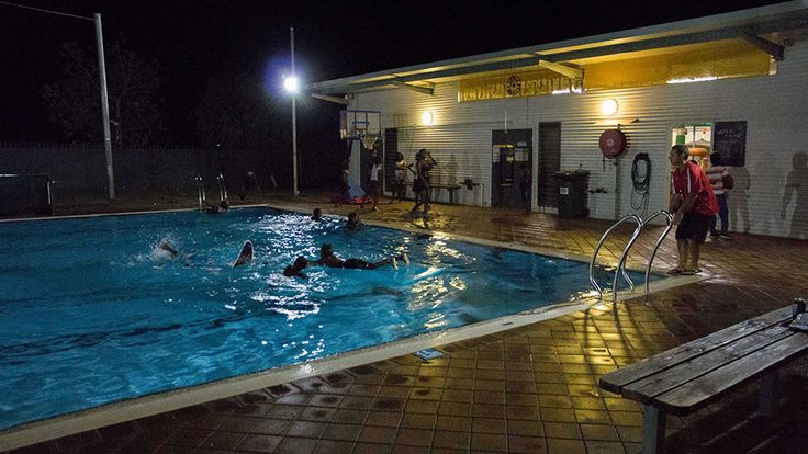Aaron Jacobs supervises children swimming in Fitzroy Crossing's public pool at midnight.